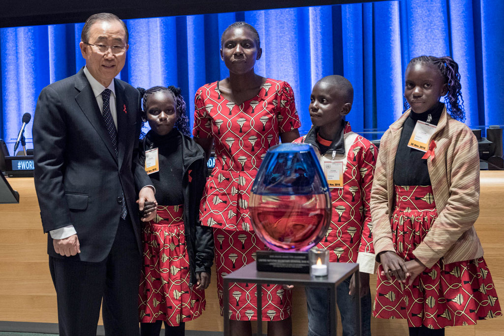 Secretary-General Ban Ki-moon (left) with Rebecca Awiti, a Kenyan mother living with HIV who has three children – all of them HIV negative, at a UNAIDS special event commemorating World AIDS Day 2016. UN Photo/Mark Garten