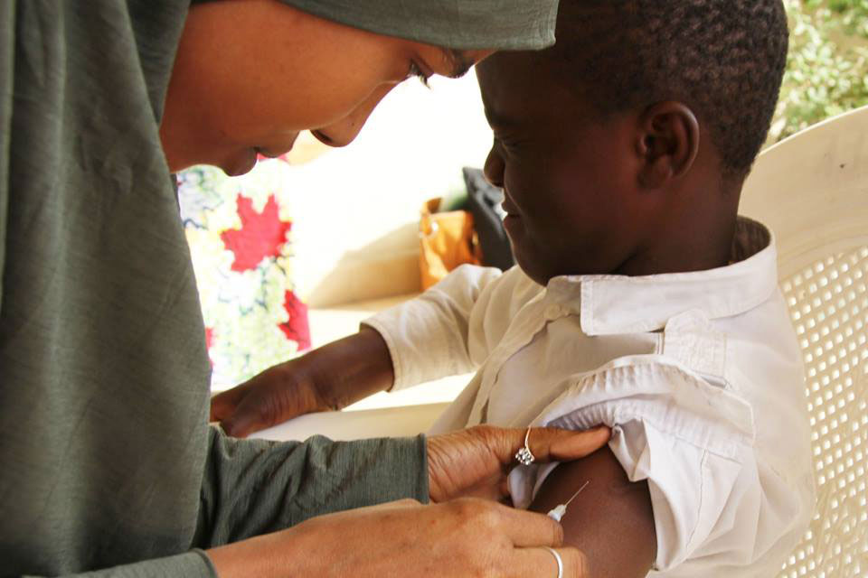 A child is vaccinated during a measles campaign targeting 4.7 million children in Adamawa, Borno and Yobe in northeast Nigeria. Photo: UNICEF Nigeria