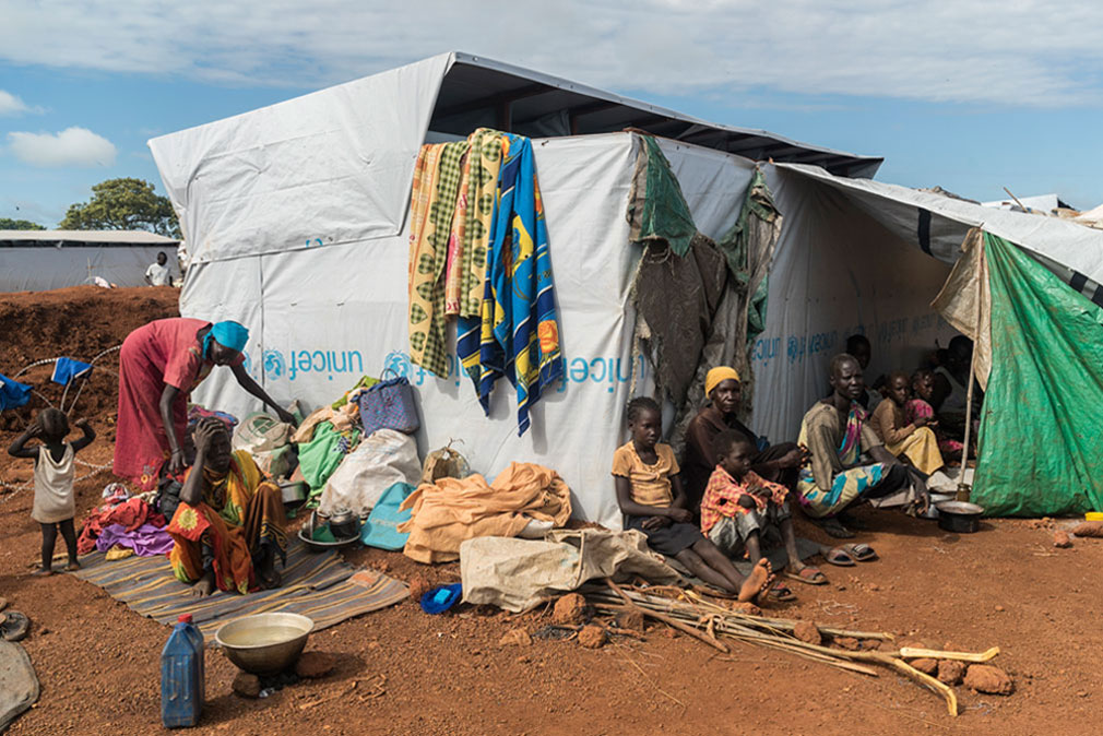 Families displaced by ongoing fighting seek shelter in the UN Protection of Civilians site in Wau, South Sudan. Photo: UNICEF/UN027532/Ohanesian
