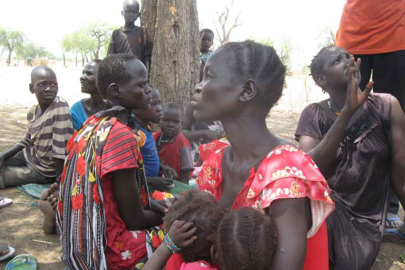 Displaced women and children under a hot sun in South Sudan's Maban County, where food shortages are causing tension. Photo: UNHCR/P. Rulashe