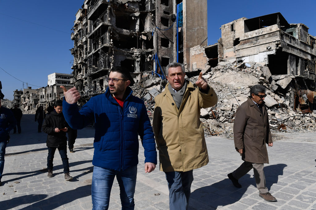 UN High Commissioner for Refugees Filippo Grandi (centre) walks past destroyed ancient buildings in the old city of Aleppo, Syria. Photo: UNHCR/Bassam Diab