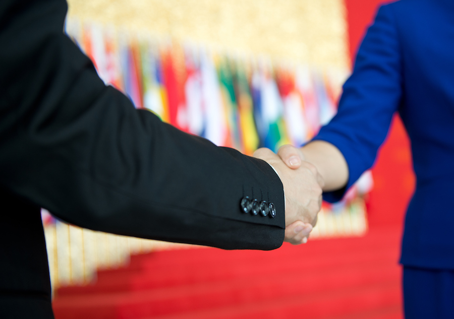 Close-up of two businesspeople shaking hands.