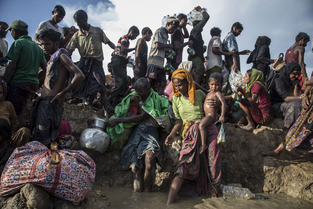 Pictured here, Rohingya refugees including women and children cross from Myanmar into Bangladesh at Palong Khali in Cox's Bazar district. Photo: UNICEF/LeMoyne